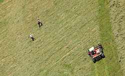 THEMENBILD - Landwirte mit Traktor mit Maehwerk und Rechen bei der Heuernte auf einem steilen Hang, aufgenommen am 11. August 2015, Maishofen, Österreich// farmers with tractor and rakes mowing hay in a Field, Maishofen, Austria on 2015/08/11. EXPA Pictures © 2015, PhotoCredit: EXPA/ JFK