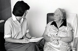 Dietician & elderly woman, Queen's Medical Centre, Nottingham, UK 1990
