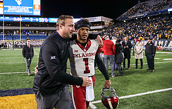 Nov 23, 2018; Morgantown, WV, USA; West Virginia Mountaineers offensive coordinator Jake Spavital talks with Oklahoma Sooners quarterback Kyler Murray (1) after the game at Mountaineer Field at Milan Puskar Stadium. Mandatory Credit: Ben Queen-USA TODAY Sports