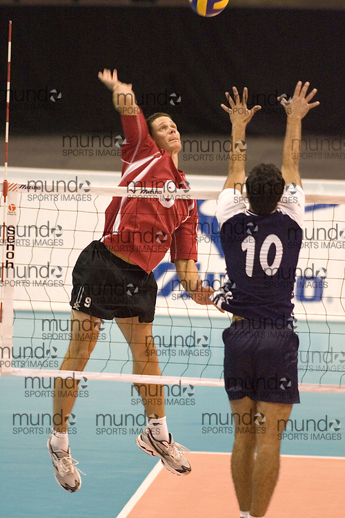 Scott Koskie hitting as Tunisia defeats Canada three games to two in the 2006 Anton Furlani Volleyball Cup. .Copyright Sean Burges / Mundo Sport Images, 2006 .Anton Furlani Cup.Copyright Sean Burges / Mundo Sport Images, 2006