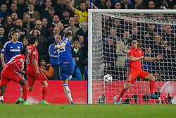 Gary Cahill of Chelsea shoots and scores a goal past Edinson Cavani of Paris Saint-Germain to make it 1-0 - Photo mandatory by-line: Rogan Thomson/JMP - 07966 386802 - 11/03/2015 - SPORT - FOOTBALL - London, England - Stamford Bridge - Chelsea v Paris Saint-Germain - UEFA Champions League Round of 16 Second Leg.