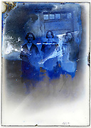 severely eroding glass plate with three woman standing full length