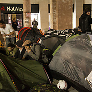 Tents are going up and people are getting ready to spend the night in the square. The London Stock Exchange was attempted occypied in solidarity with Occupy Wall in Street in New York and in protest againts the economic climate, blamed by many on the banks. Police managed to keep people away fro the Patornoster Sqaure and the Stcok Exchange and thousands of protestors stayid in St. Paul's Square, outside St Paul's Cathedral. Many camped getting ready to spend the night in the square.