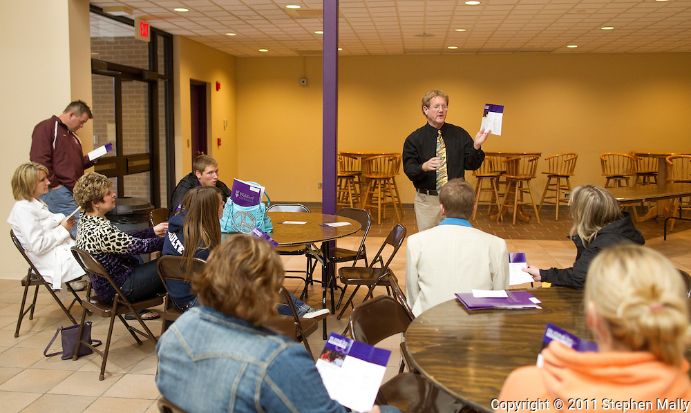 Professor John Robinson talks to prospective students and their parents interested in business majors during an open house at Waldorf College in Forest City, Iowa on Saturday, May 14, 2011.