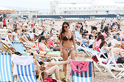 © Licensed to London News Pictures. 01/07/2015. Brighton, UK. People Sunbathe on Brighton beach and swim in the sea on the hottest day of the year, today July 1st 2015. Photo credit : Hugo Michiels/LNP