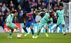 """Arsenal's Matteo Guendouzi (left) and Lucas Torreira (right) battle for the ball with Crystal Palace's Jordan Ayew (centre) during the Premier League match at Selhurst Park, London. PRESS ASSOCIATION Photo. Picture date: Sunday October 28, 2018. See PA story SOCCER Palace. Photo credit should read: Tim Goode/PA Wire. RESTRICTIONS: EDITORIAL USE ONLY No use with unauthorised audio, video, data, fixture lists, club/league logos or """"live"""" services. Online in-match use limited to 120 images, no video emulation. No use in betting, games or single club/league/player publications."""
