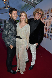 Left to right, EVANGELO BOUSIS, EUGENIE NIARCHOS and PETER DUNDAS at British Vogue's Centenary Gala Dinner in Kensington Gardens, London on 23rd May 2016.