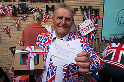 © London News Pictures. 30/04/2015. Royal fan Terry Hutt holding a birthday cake and card sent to him by staff at Kensington Palace on his 80th birthday as he waits outside Lindo Wing of St Mary's hospital in Padding, where The Duchess is due to give birth. Photo credit: Ben Cawthra/LNP