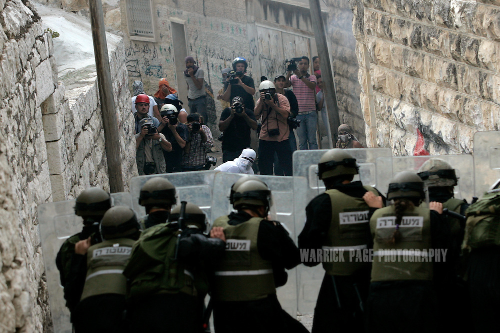 EAST JERUSALEM, OCTOBER 9: Local and international media photograph and film Palestinian and Israelis engaged in a riot in the Palestinian neighbourhood of Ras al'Amud, on October 9, 2009, in East Jerusalem. (Photo by Warrick Page)