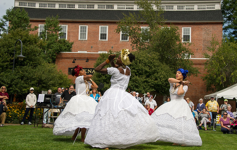 SambaViva, a Brazilian dance group, performing the Baiana dance at Rotary Park during Laconia's Multicultural Festival on Saturday.  (l-r Mariona Lloreta, Randi Henry and Ines Ouedraogo.  (Karen Bobotas/for the Laconia Daily Sun)