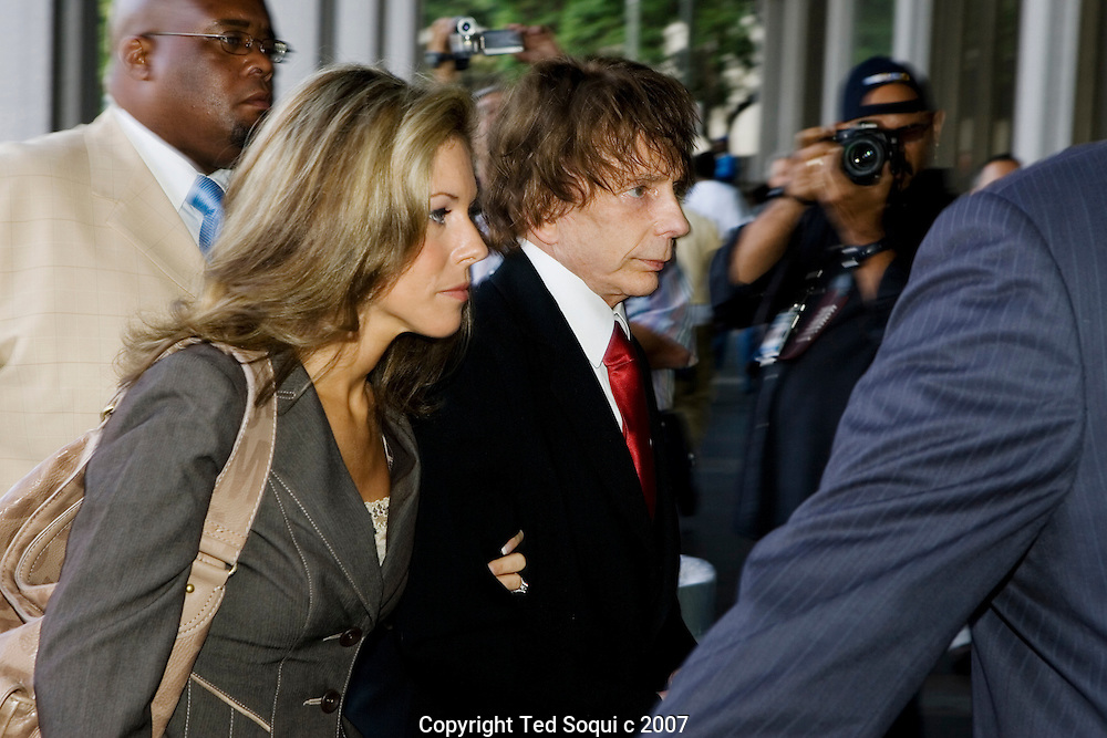 This is a rare shot. Spector's mountain size body guards usually block any photogs from getting close to Phil And Rachelle. .Phil Spector arrives to court with his wife Rachelle..Closing arguments have begun in the case against him..Spector, 67, is accused of fatally shooting 40-year-old actress Lana Clarkson around 5 a.m. Feb. 3, 2003 at his Alhambra home. He maintains she committed suicide.. Spector, renowned in music circles for his legendary ``Wall of Sound'' recording technique, is free on $1 million bail. If convicted, he faces 15 years to life imprisonment with a possible added 10-year penalty for use of a firearm..Criminal Courthouse Building, Downtown LA, CA