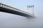 Manhattan bridge New York City in early morning fog