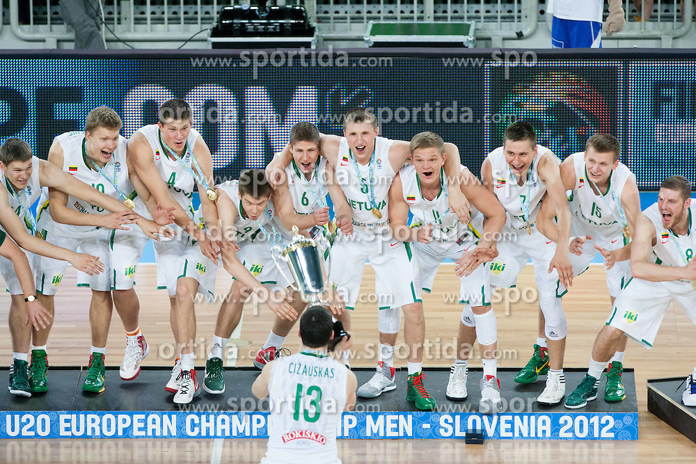 Vytenis Cizauskas of Lithuania and Winning team of Lithuania celebrate during Trophy ceremony after the basketball match between National teams of Lithuania and France in final match of U20 Men European Championship Slovenia 2012, on July 22, 2012 in SRC Stozice, Ljubljana, Slovenia. Lithuania defeated France 50-49 and became European Champion 2012. (Photo by Vid Ponikvar / Sportida.com)
