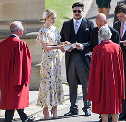 © Licensed to London News Pictures. 19/05/2018. London, UK. CAREY MULLIGAN and MARCUS MUMFORD. Guests arrive at The wedding of Prince Harry, The Duke of Sussex to Meghan Markle, The Duchess of Sussex, at St George's Chapel in Windsor. Photo credit: Ben Cawthra/LNP