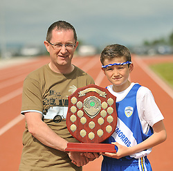 Claremorris won the best turned out in the parade at the Mayo Commmunity Games finals, Gerry McGuinness Chairman present the award to Jack Sheridan from Claremorris.<br /> Pic Conor McKeown