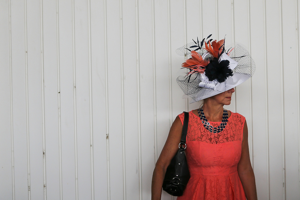 LOUISVILLE, KY - MAY 7:  A woman in a festive hat looks on prior to the 142nd running of the Kentucky Derby at Churchill Downs on May 7, 2016 in Louisville, Kentucky. (Photo by Michael Reaves/Getty Images)