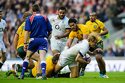 England Inside Centre (#12) Billy Twelvetrees (Gloucester Rugby)  is tackled by Australia replacement (#20) Ben McCalman (Western Force) during the second half of the match - Photo mandatory by-line: Rogan Thomson/JMP - Tel: Mobile: 07966 386802 02/11/2013 - SPORT - RUGBY UNION -  Twickenham Stadium, London - England v Australia - Cook Cup - QBE Autumn Internationals.