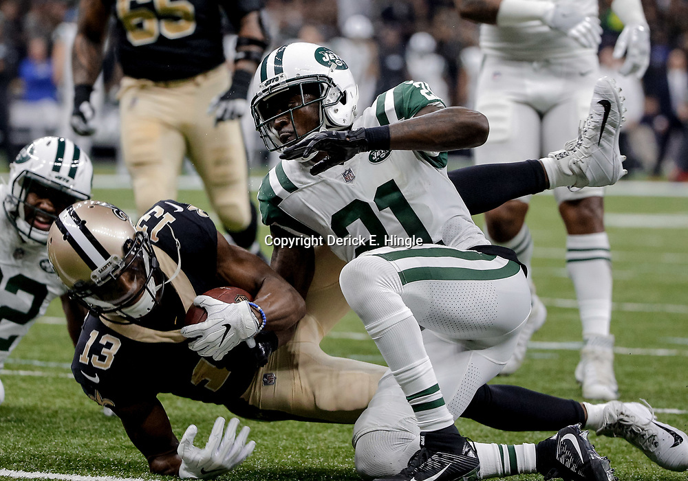 Dec 17, 2017; New Orleans, LA, USA; New Orleans Saints wide receiver Michael Thomas (13) is tackled near the goaline by New York Jets cornerback Morris Claiborne (21) during the first quarter at the Mercedes-Benz Superdome. Mandatory Credit: Derick E. Hingle-USA TODAY Sports