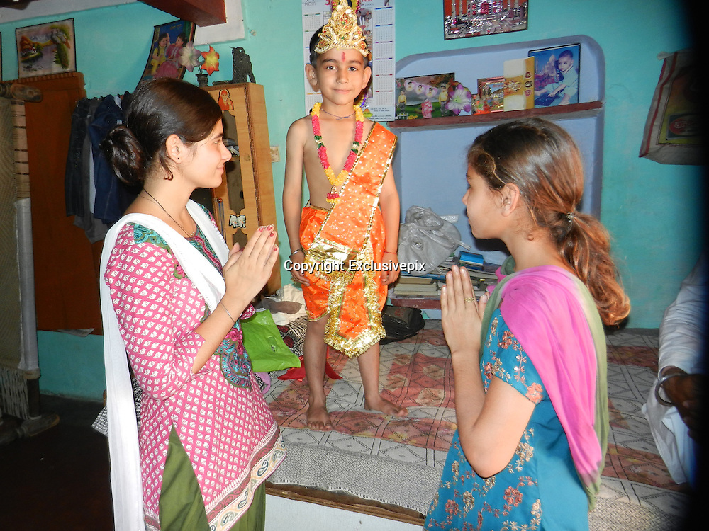 """EXCLUSIVE<br /> A boy in India is being worshipped as a god-like figure after growing a """"tail"""".<br /> Amar Singh, aged six, has a patch of thick hair on the small of his back, which has grown to more than 12 inches in length to resemble a tail.<br /> He is from Nijmapur, a small village in the state of Uttar Pradesh in northern India.<br /> The family and locals believe that this is some kind of sign that he is connected to the Hindu god Hanuman, a monkey-like deity.<br /> They have also come up with the theory that his condition means that he bears some similarity to a cow, an animal which is considered holy in Hindu culture. This view has been reinforced by the fact that Amar enjoys spending his time playing with cows in the village.<br /> The family say that he was born with the anomalous patch of hair, which was about one inch in length, and then grew over the years. They say that he is healthy and otherwise a normal boy who does well in his studies at school.<br /> """"Amar is very loving child,"""" says Amar's father, Ajmer Singh. """"Everybody see him a symbol of god.""""<br /> He explains that although the hairs could be easily cut, they do not want to so because they consider them to be a """"gift from god"""".<br /> Amar is the youngest in the family, with four sisters and one brother.<br /> ©Exclusivepix"""