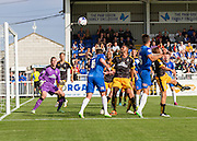 Chris Dunn (Cambridge United) watches the ball go wide from a header from Scott Harrison (Hartlepool United) during the Sky Bet League 2 match between Hartlepool United and Cambridge United at Victoria Park, Hartlepool, England on 19 September 2015. Photo by George Ledger.