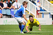 Peterborough No 8 Chris Forrester fouls in the Friendly match between Peterborough United and Leeds United at London Road, Peterborough, England on 23 July 2016. Photo by Nigel Cole.