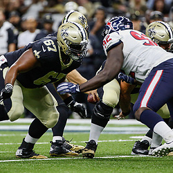 Aug 26, 2017; New Orleans, LA, USA; New Orleans Saints guard Larry Warford (67) blocks Houston Texans defensive end Brandon Dunn (92) during the first quarter of a preseason game at the Mercedes-Benz Superdome. Mandatory Credit: Derick E. Hingle-USA TODAY Sports
