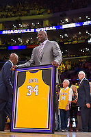 02 April 2013: Shaquille O'Neal stands with his framed jersey during the jersey retirement ceremony for retired Los Angeles Lakers center (34) Shaquille O'Neal during halftime of  the Lakers 101-81 victory over the Dallas Mavericks at the STAPLES Center in Los Angeles, CA.