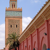 Minaret of Kasbah Mosque in Marrakech, Morocco<br /> The Kasbah Mosque is next to Bab Agnaou, one of the main city gates. Both were built in the late 12th century during the Almohad dynasty. They were commissioned by Sultan Abu Yusuf Yaqub al-Mansur.  He was the Caliph of Morocco from 1184 &ndash; 1199. This former royal mosque is also called Moulay el Yazid. Although non-Muslims are prohibited from entering this place of worship, you can visit the adjacent Saadian Tombs.