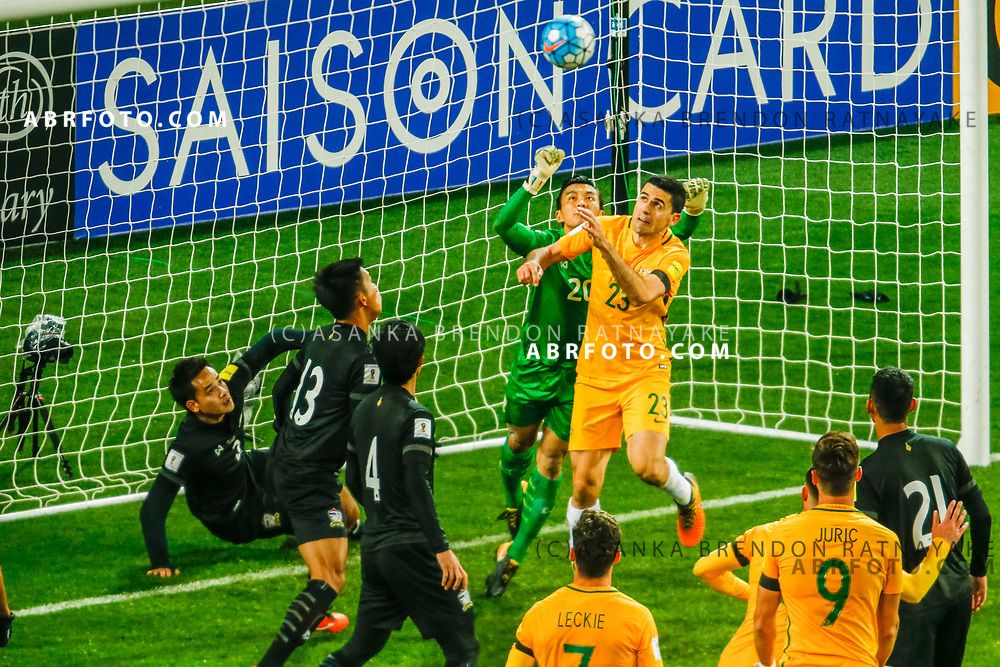 MELBOURNE, AUSTRALIA - SEPTEMBER 5 : Sinthaweechai Hathairattanakool of Thailand and Tomas Rogic of the Australia Socceroos contest for the ball during the Stage 3 Group World Cup Football Qualifiers between Australia Vs Thailand at the Melbourne Rectangular Stadium, Melbourne, Australia 5 September 2017.
