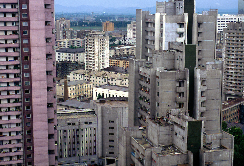 NORTH KOREA: Pyongyang.City centre is characterised by bland apartment buildings, where electricity is rationed to one light bulb until 9pm, after which blackness ensues.