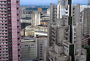 NORTH KOREA: Pyongyang.City centre is characterised by bland apartment buildings, where electricity is rationed to one light bulb until 9pm, after which blackness ensues. Featureless, dour and grey apartment buildings of the North Korean capital, Pyongyang