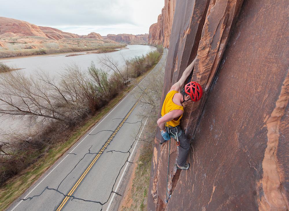 Jon Bouchard on El Cracko Diablo, 5.10a on Wallstreet in Moab