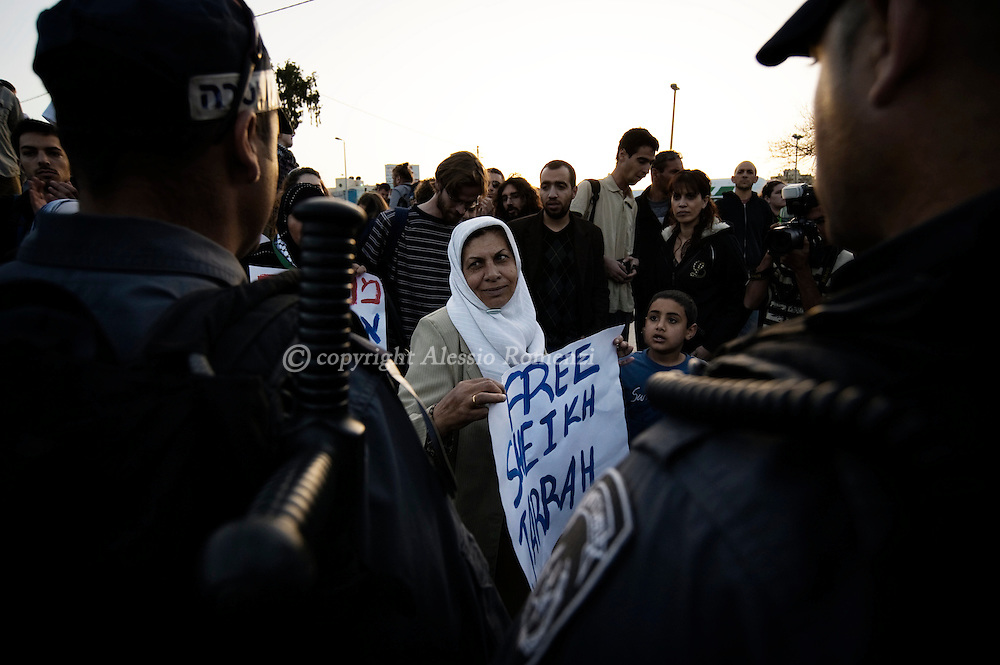 .Jerusalem: Israeli forces stand opposite Palestinian and left-wing Israeli demonstrators in the mostly Arab east Jerusalem neighborhood of Sheikh Jarrah on February 19, 2010 against Israeli settlements and occupation.© ALESSIO ROMENZI