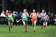 Dec 2, 2017; Portland, OR, USA; James Mwaura (31) of Northwest, Brodey Hasty (1) of Southeast Aidan Troutner (52) of Southwest and Danny Kilrea (21) of Midwest lead the boys' race during the 2017 Nike Cross Nationals at Glendoveer Golf Course. Troutner won in 15:03.9.