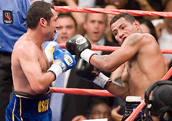 May 6, 2006 - Las Vegas, NV - Oscar DeLaHoya (l) and Ricardo Mayorga (r) trade punches during their 12 round fight for the WBC Super Welterweight Championship at the MGM Grand Garden Arena.  DeLaHoya captured the title via 6th round TKO.