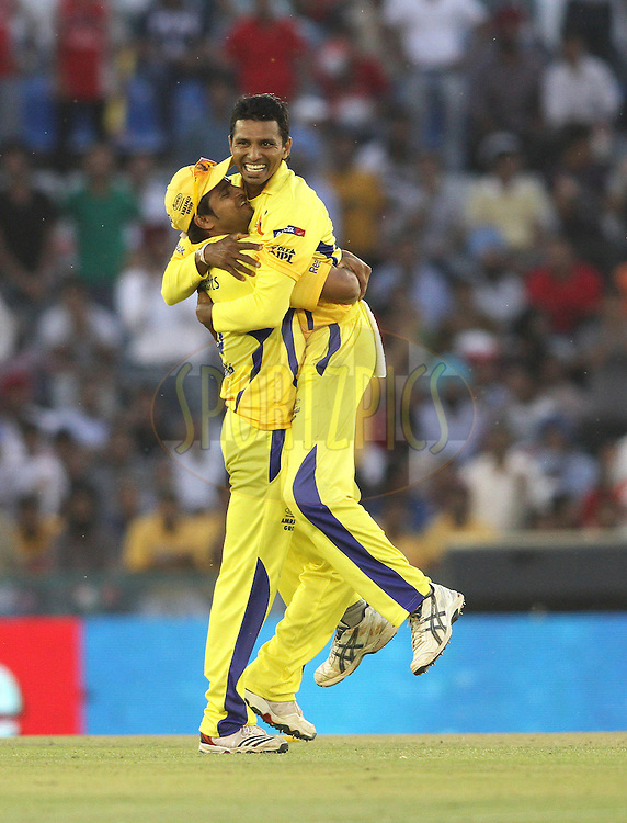 Suresh Raina of the Chennai Super Kings congratulates Suraj Randiv of the Chennai Super Kings on getting a wicket during match 9 of the Indian Premier League ( IPL ) Season 4 between the Kings XI Punjab and the Chennai Super Kings held at the PCA stadium in Mohali, Chandigarh, India on the 13th April 2011..Photo by Shaun Roy/BCCI/SPORTZPICS