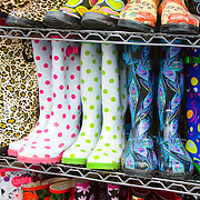 Brightly coloured boots for sale at Camden Market, London. Camden is known as the centre of London's alternative culture.