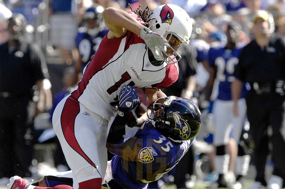 23 September 2007:  Arizona Cardinals wide receiver Larry Fitzgerald (11) catches a 27-yard pass in the 3rd quarter and then is stripped of the ball by Baltimore Ravens cornerback Corey Ivy (35) who recovered the fumble.  The Ravens defeated the Cardinals 26-23 on a 46 yard field goal by Matt Stover with no time remaining at M&T Bank Stadium in Baltimore, Md. .