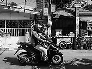 17 DECEMBER 2018 - BANGKOK, THAILAND: A motorcycle taxi in a working class neighborhood about one kilometer from Siam Paragon, an exclusive mall in central Bangkok. According to Credit Suisse Global Wealth Databook 2018, which surveyed 40 countries, Thailand has the highest rate of income inequality in the world. In 2016, Thailand was third, behind Russia and India. In 2016, the 1% richest Thais (about 500,000 people) owned 58.0% of the Thailand's wealth. In 2018, they controlled 66.9%. In Russia, those numbers went from 78% in 2016, down to 57.1% in 2018. The Thai government disagreed with the report and said the report didn't take government anti-poverty programs into account and that Thailand was held to an unfair standard because most of the other countries in the report are developed countries in the Organisation for Economic Co-operation and Development.     PHOTO BY JACK KURTZ