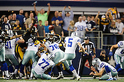 Dallas Cowboys kicker Dan Bailey (5) kicks the game winning field goal against the Pittsburgh Steelers in overtime, 27-24, at Cowboys Stadium in Arlington, Texas, on December 16, 2012.  (Stan Olszewski/The Dallas Morning News)