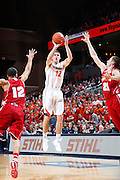 CHARLOTTESVILLE, VA - DECEMBER 4: Joe Harris #12 of the Virginia Cavaliers shoots the ball against the Wisconsin Badgers during the Big Ten/ACC Challenge game at John Paul Jones Arena on December 4, 2013 in Charlottesville, Virginia. Wisconsin won 48-38. (Photo by Joe Robbins) *** Local Caption *** Joe Harris