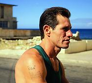 Man with America flag tattoo in Santa Fe, western Havana, Cuba.
