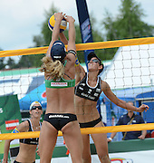 STARE JABLONKI POLAND - July 5: Barbara Hansel and Doris Schwaiger /1/ and Stefanie Schwaiger of Austria in action during Day 5 of the FIVB Beach Volleyball World Championships on July 5, 2013 in Stare Jablonki Poland.  (Photo by Piotr Hawalej)