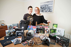 Marina Murphy and Faye Bradley at home in Ennis , Co Clare Ireland with some of the 180 prizes they have won so far. Photograph by Eamon Ward