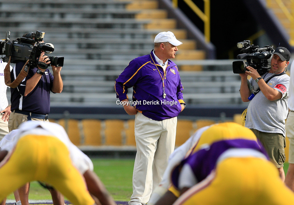 Mar 27, 2009; Baton Rouge, LA, USA;  LSU Tigers head coach is filmed by television crews as a watches his team during the second half of the 2010 Spring Game at Tiger Stadium.  Mandatory Credit: Derick E. Hingle-US PRESSWIRE