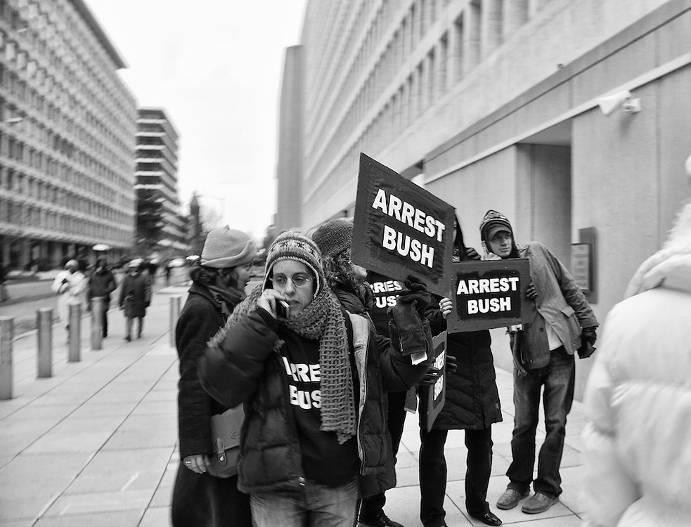 """Anti George Bush protesters congregate after the conclusion of the """"We Are One"""" Obama inaugural concert."""