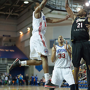 Delaware 87ers Guard Lorenzo Brown (17) drives towards the basket as Erie BayHawks Forward Terrence Jennings (21) in the first half of a NBA D-league regular season basketball game between Delaware 87ers (76ers) and the Erie BayHawks (Knicks) Friday, Jan. 3, 2014 at The Bob Carpenter Sports Convocation Center, Newark, DE