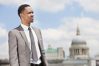 African American businessman looking away with St. Paul's Cathedral in the background