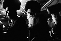 Borough Park, Brooklyn, New York. Jewish orthodox men (in the center Rabbi Efraim Bornstein, executive director of the Congregation Shaarei Zion of Bobov), attending Zvi Tauber's wedding. Zvi Tauber is Gran Rabbi Ben Zion Halberstam's nephew. Thousands of people, part of this community, were invited to celebrate the public wedding. Gianni Cipriano, cell +1 646 465 2168 (USA), +39 328 567 7923 (Italy), gianni@giannicipriano.com , www.giannicipriano.com