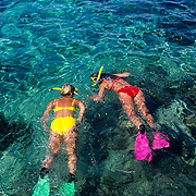 Two woman in bikini snorkeling in Cozumel. Quintana Roo, Mexico